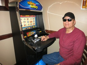 Richard Luvis likes to gamble six cents at a time at Oregon Lottery's new video poker terminals.