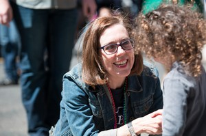 Oregon Gov. Kate Brown stops to thank a child named Clementine for coming out to support the LGBT community during the Portland Pride Parade Sunday, June 19, 2016.