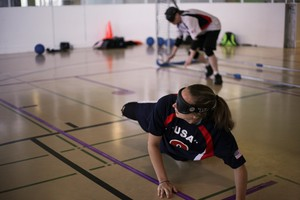 Eliana Mason, right, dives to block a goal during a practice match of goalball in Portland, Oregon. Mason, a student a Portland State University, is competing in her first Paralympic Games in Rio in September as a member of the U.S. goalball team.
