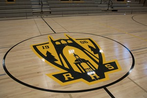Roosevelt High School's gym floor features a new logo for the high school. The center of the old basketball court is now embedded in a nearby lobby floor — a nod to Roosevelt's history.