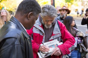 Neil Wampler, right, signs a napkin outside the federal courthouse in downtown Portland.