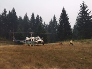 A helicopter crew prepares to make water drops on the Archer Mountain Fire in this Sept. 9, 2017, photo.