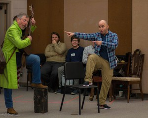 """Figaro (Malcolm McKenzie, baritone) and Count Almaviva (Javier Abreu, tenor) come up with a plan in a room rehearsal of Eugene Opera's production of """"The Barber of Seville."""""""