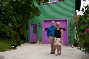 Jennifer and Mark Wyld of Vancouver stand outside their home and accessory dwelling unit.