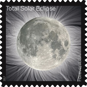 This image provided by the U.S. Postal Service shows a Total Solar Eclipse Forever stamp. The stamp, that when touched transforms the image of the blacked-out sun into the moon, comes out in June 2017, on the Summer Solstice.