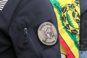 A militia patch on the arm of a protester in Burns, Oregon.