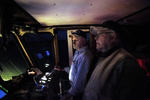 Milton Gudgell, right, and his son Rob Gudgell on a nighttime boat ride to East Sand Island.