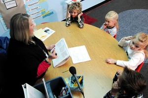 Kindergarten teacher Cami Railey explains the rules of the 'Good Behavior Game' to her pupils.