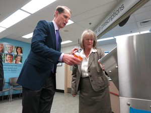 Congressman Ron Wyden and state Senator Laurie Monnes Anderson, try the new medicine drop-off kiosk at Walgreens in Gresham.