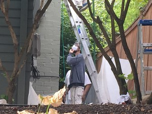 A crew with Bridgetown Painting gets ready to paint the side of an older home in Southeast Portland.