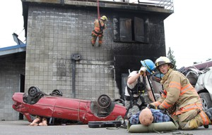 First responders rescue dummies from crumpled cars during the Cascadia Rising earthquake simulation in 2016.