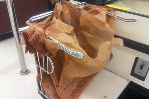Plastic bags at a grocery store checkout.