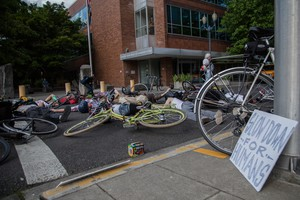In this 2015 photo, over 30 bicycle riders and advocates gathered outside of Oregon Department of Transportation offices in Portland, Oregon. The riders gathered to protest unsafe road conditions after a cyclist lost a limb in an accident.