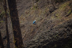 A crew member works on a section of the Pacific Crest Trail damaged in the Eagle Creek Fire.