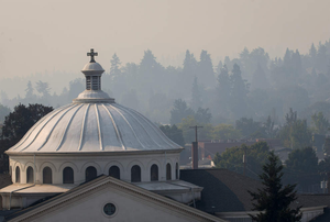 First Christian Church in Eugene seen through the pale haze of wildfire smoke that again infiltrated the Willamette Valley Friday.
