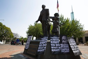 Signs in front of the Martin Luther King Jr. statue at the Oregon Convention Center in Portland on Aug. 12, 2017.