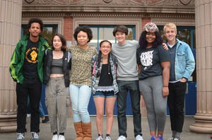 Dylan Palmer, Eileen Conley, Brianna Henderson, Alejandra Alvarado, Mackie Mallison, Sade Means and Finn Hawley-Blue pose in front of Grant High.