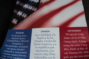 A poster made by staff in Vancouver Public Schools to help ESL children feel comfortable saying the American pledge of allegiance. In Russian, staff replaced 'pledge' with 'promise,' because Christian Ukrainians don't believe in pledging allegiance to anyone except God.