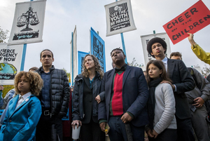 Julia Olsen, chief legal counsel for Our Children's Trust, third from left, stands with some of the 21 youth plaintiffs she is representing in Juliana vs. United States during a rally at the United States District Courthouse in Eugene, Oregon, Monday, Oct. 29, 2018.