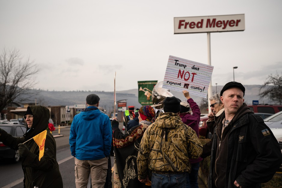 Ross Eliot, a leftist activist and proponent for armed self-defense, looks behind the Women's March for any possible threats on Jan. 19, 2019 in The Dalles, Ore.