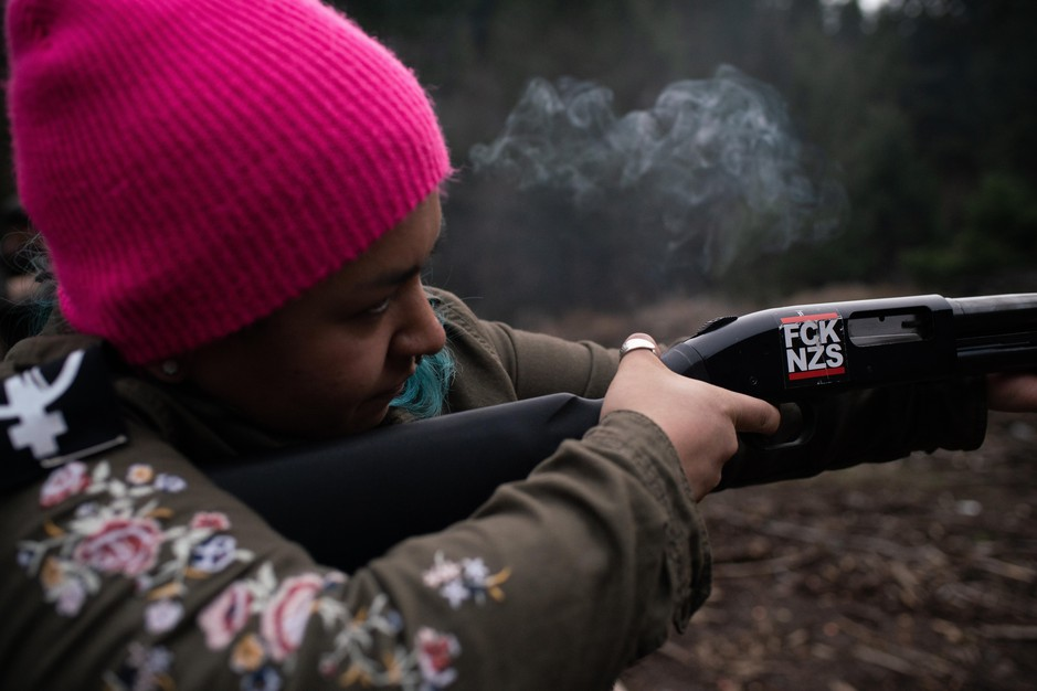 Rosie Strange, a leftist activist who chose to buy a handgun for self defense, fires a friend's shotgun on February 2, 2019, in Hood River, Oregon.