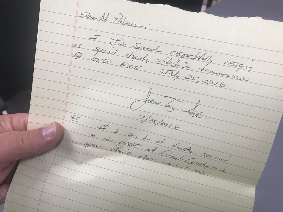 Grant County Sheriff Glenn Palmer holds a letter of resignation froma former special deputy.