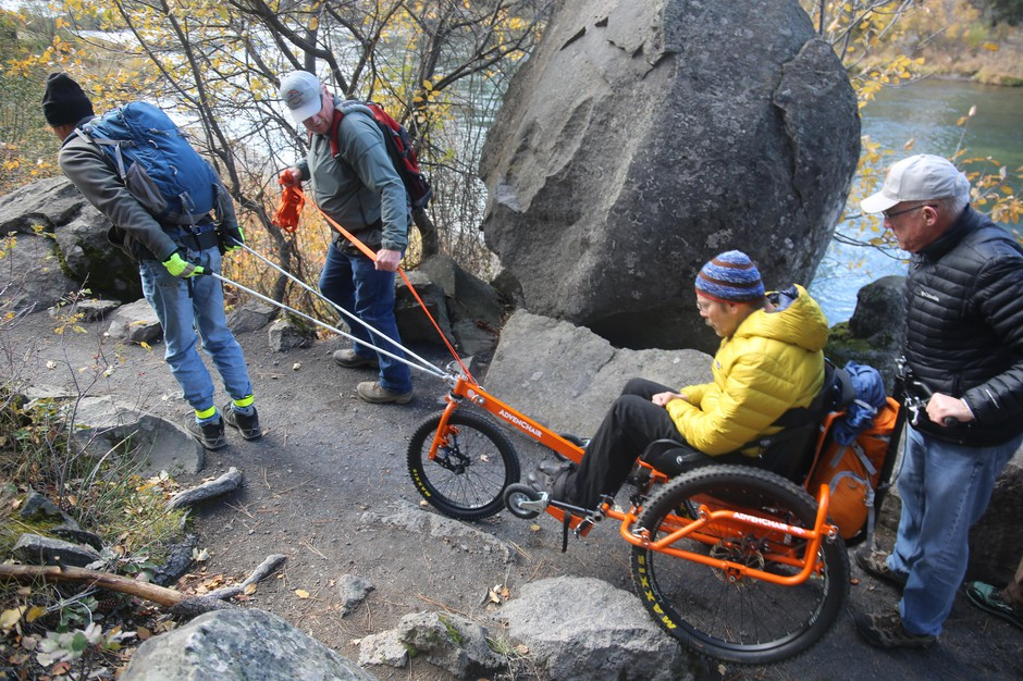 Navigating the trail with an AdvenChair rider requires problem solving and teamwork.