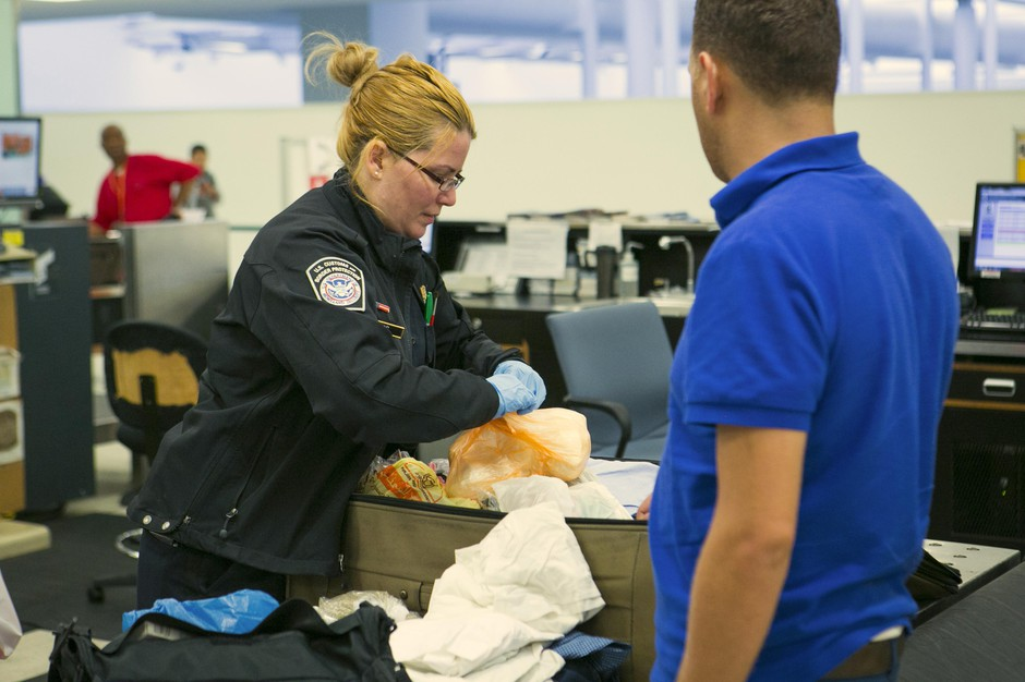 CBP Agriculture Specialists process passengers who have food products in their luggage as they arrive to the United States.