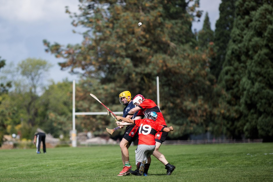 Players clash during a 2017 pub league hurling match in Portland.