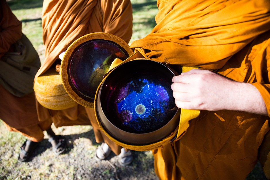 Ajahn Sudanto displays the inside of his alms bowl. He likens the interior to a starry night.