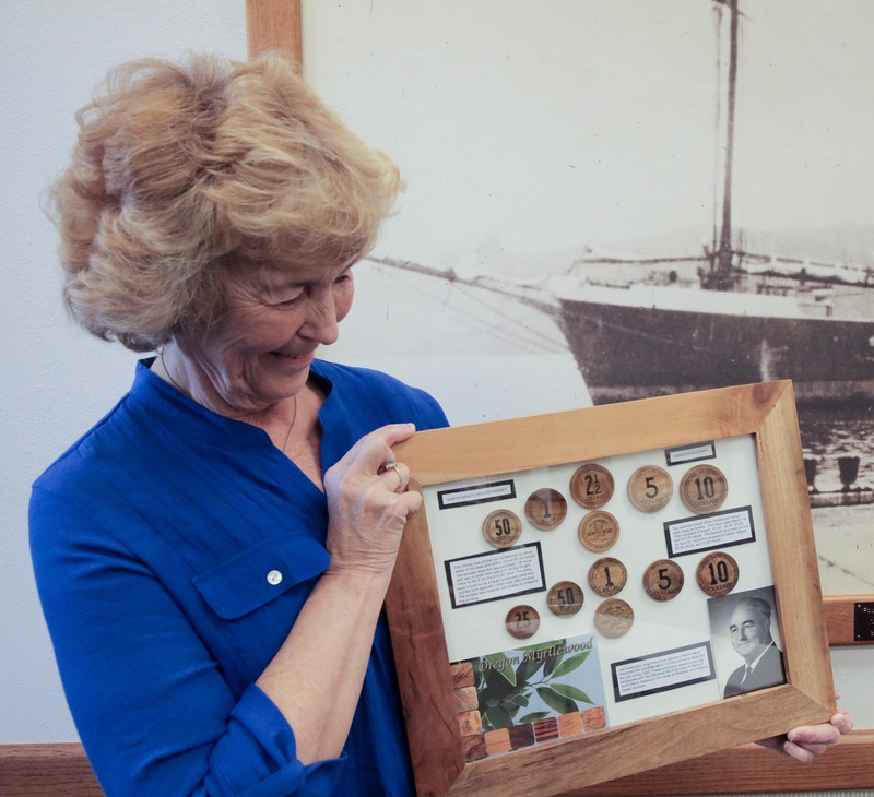 North Bend resident Kristie Robertson Smith possesses one of the few known complete collections of myrtlewood currency. She has one of each denomination from both issues, including the rare $10 pieces.