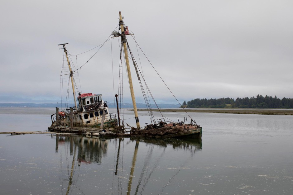 R/V Hero, a 125-foot wooden-hulled Antarctic research vessel, sank in March 2017 on the Palix River near Bay Center, Washington. Built in 1968, she was fitted with sails and labs for wildlife research but now poses a threat to oysters, other wildlife and navigation.