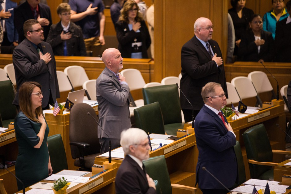 State Rep. Bill Post, R-Keizer, takes the Pledge of Allegiance in the Oregon House of Representatives, Salem, Ore., Monday, Jan. 14, 2019.