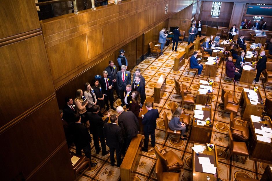 Republican state senators caucus near the water cooler in the Oregon Senate on Monday, Jan. 14, 2019, in Salem, Ore.