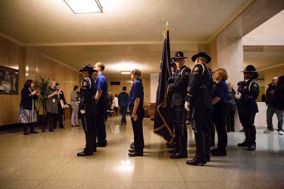 Oregon State Police troopers prepare to enter the House chamber before Gov. Kate Brown's inaugural address at the state Capitol in Salem, Ore., Monday, Jan. 14, 2019.