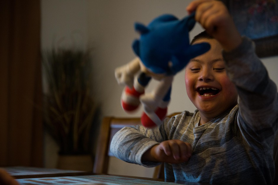 Romeo, 7, swings a stuffed Sonic the Hedgehog in his family home in Vancouver, Wash., Saturday, March 2, 2019. Romeo has Down syndrome and his family has struggled to find adequate care from schools in southwest Washington.