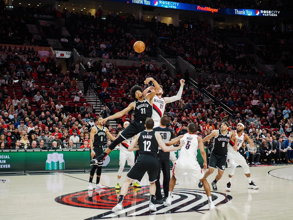 Jarrett Allen (31) and Jusuf Nurkic (27) tip off a regular season game between the Portland Trail Blazers and the Brooklyn Nets at the Moda Center in Portland, Ore., Friday, March 25, 2019.