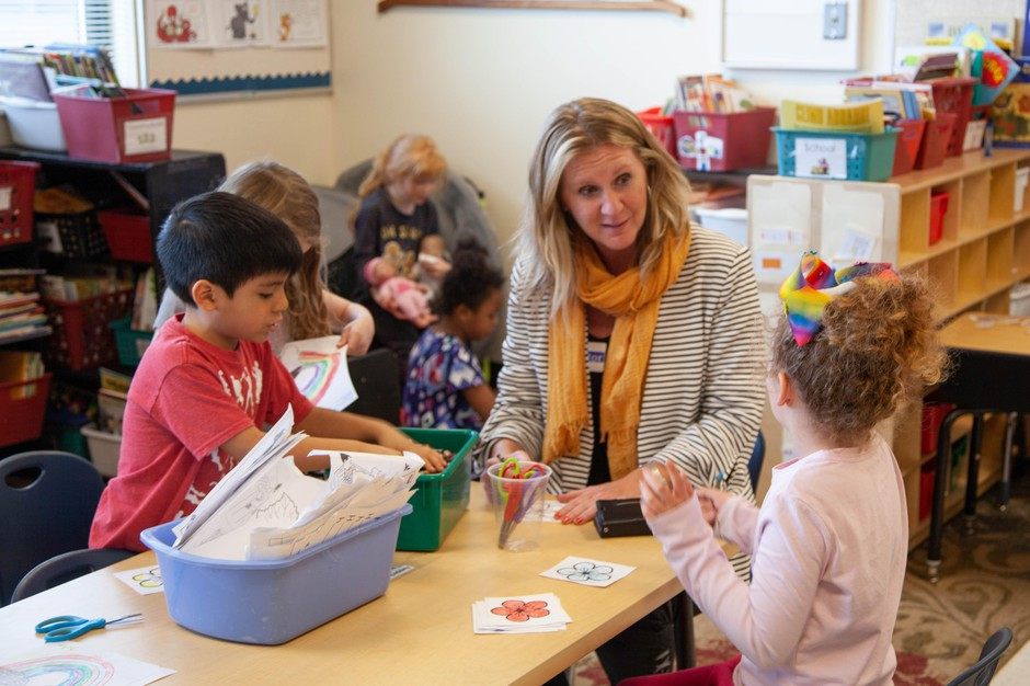 Kendra Coates sits with kindergarteners at Redmond Early Learning Center