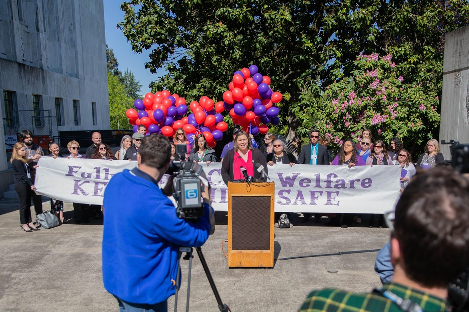 Melissa Unger, the executive director of SEIU Local 503, speaks during a rally for Oregon Child Welfare caseworkers in Salem, Ore., April 30, 2019.