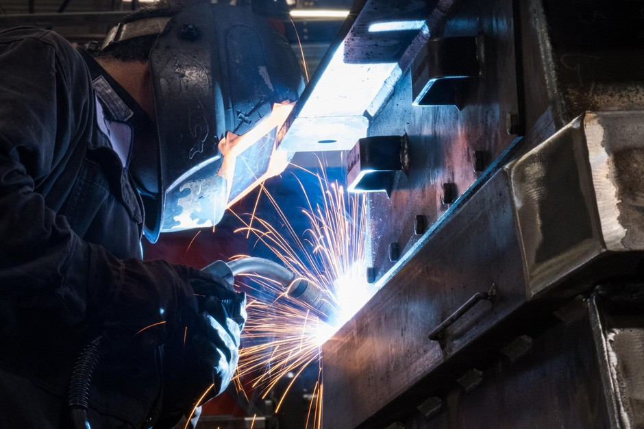 Jose Ceja welds a part for an industrial shredder at SSI Shredding Systems, Inc. at its factory in Wilsonville, Ore., on Wednesday, May 15, 2019. SSI leaders worry the ongoing trade war between the U.S. and China will force buyers to look elsewhere for products like theirs, despite SSI's nearly 40 years in business.
