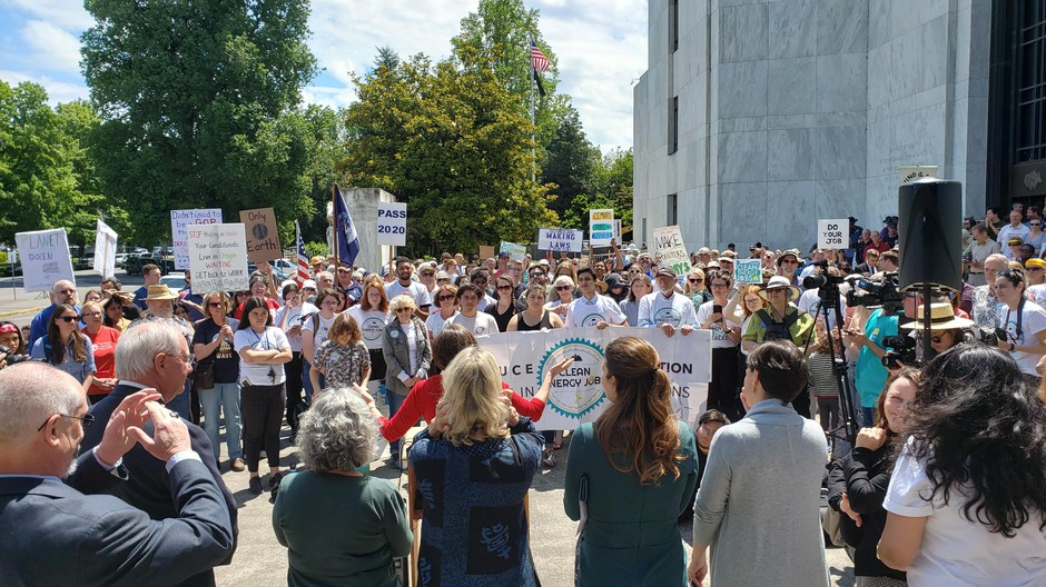 Climate action supporters gather on the Oregon Capitol steps Tuesday, June 25, 2019.