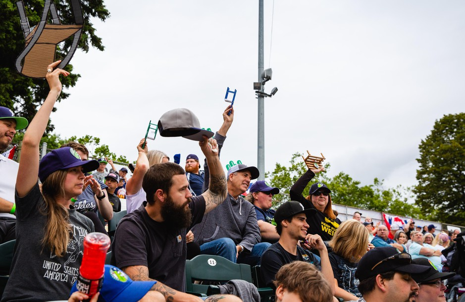 """Fans """"raise the chairs"""" cheering on the Portland Pickles."""