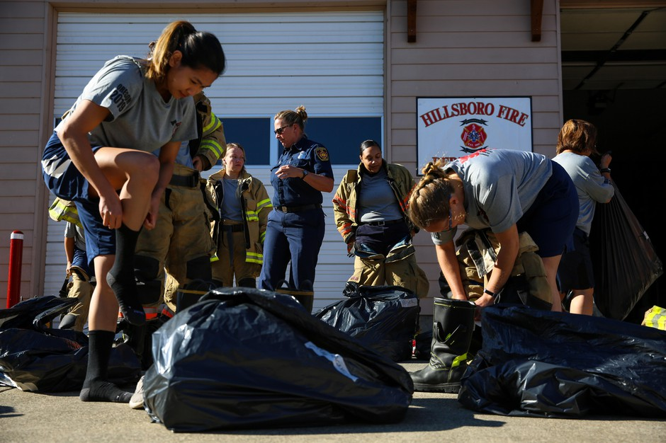 Members of the Fire-Up Bootcamp begin their training by gearing up.