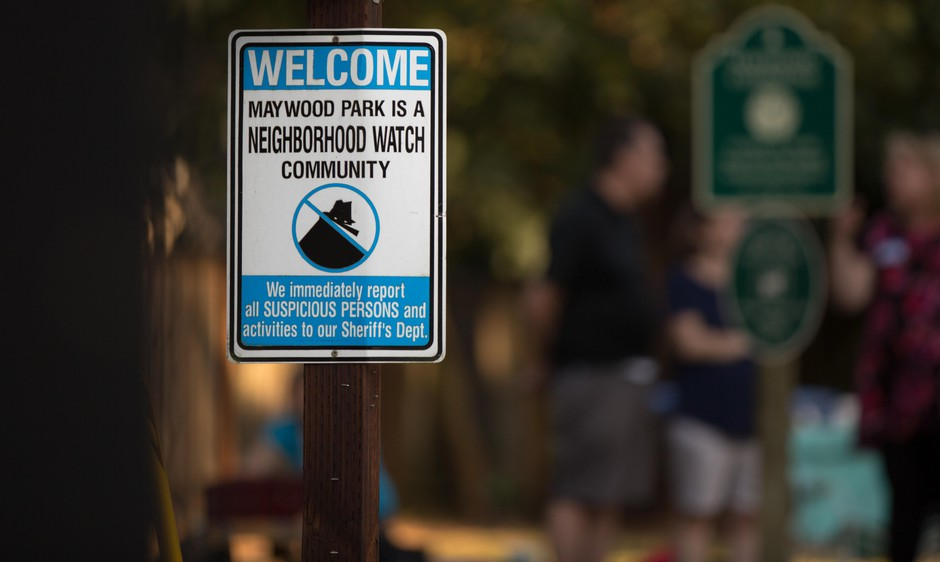 A sign warns would-be troublemakers that Maywood Park, Ore., residents are watching.