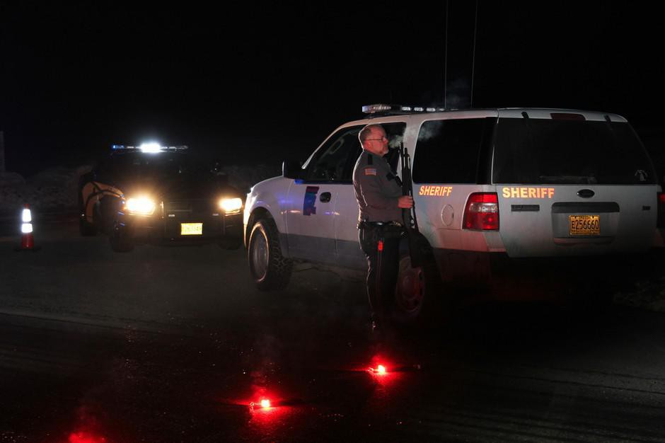 Grant County Sheriff Glenn Palmer stands at a roadblock on Highway 395 near Seneca, Ore., in a 2016 file photo.