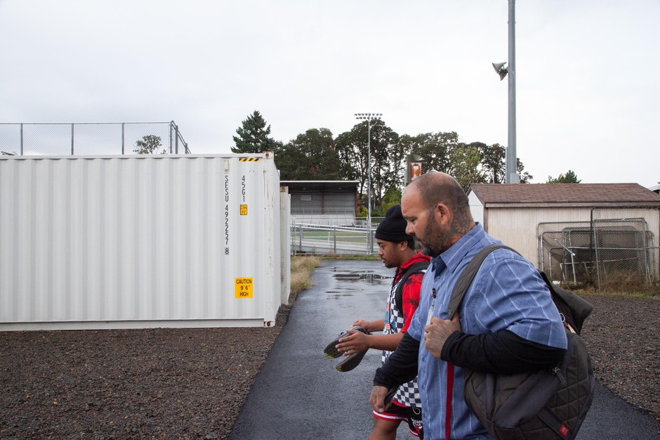 Ken Ramirez walks with Humble, a senior, at North Salem High School in Salem, Ore., Tuesday, Sept. 17, 2019. Community resource specialists like Ramirez help student groups achieve academic success with one-on-one support.