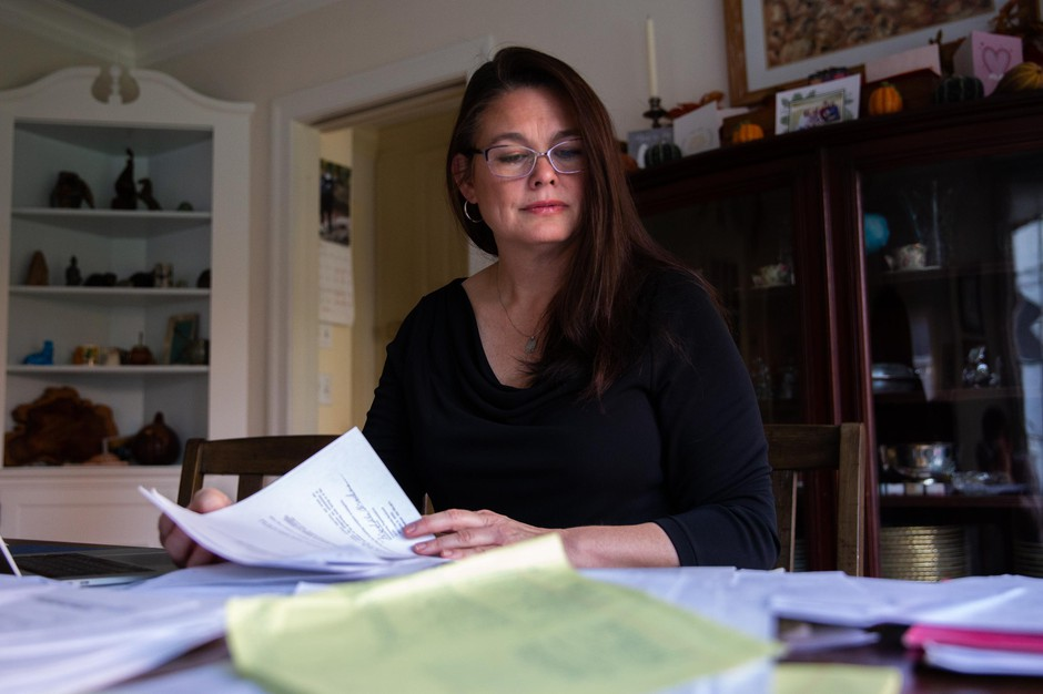 Oregon state Sen. Sara Gelser, D-Corvallis, pores over documents related to the state's foster care crisis at her dining room table in Corvallis, Ore., Monday, Nov. 11, 2019.