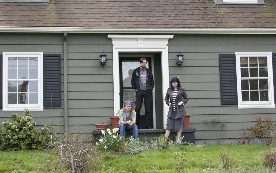 """Left to right,Johnnemann Nordhagen, Steve Gaynor and Karla Zimonja in front of their home in Portland. The trio lived in this house while they made the video game """"Gone Home."""""""