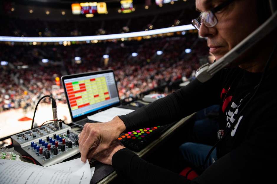 """John """"JJ"""" Jackson flips through his script for a National Basketball Association Game between the Portland Trail Blazers and San Antonio Spurs at the Moda Center in Portland, Ore., Thursday, Feb. 6, 2020. The gameday operations crew for the Trail Blazers starts each game with a script listing guest appearances, performances and promotions usually totaling more than 40 pages."""