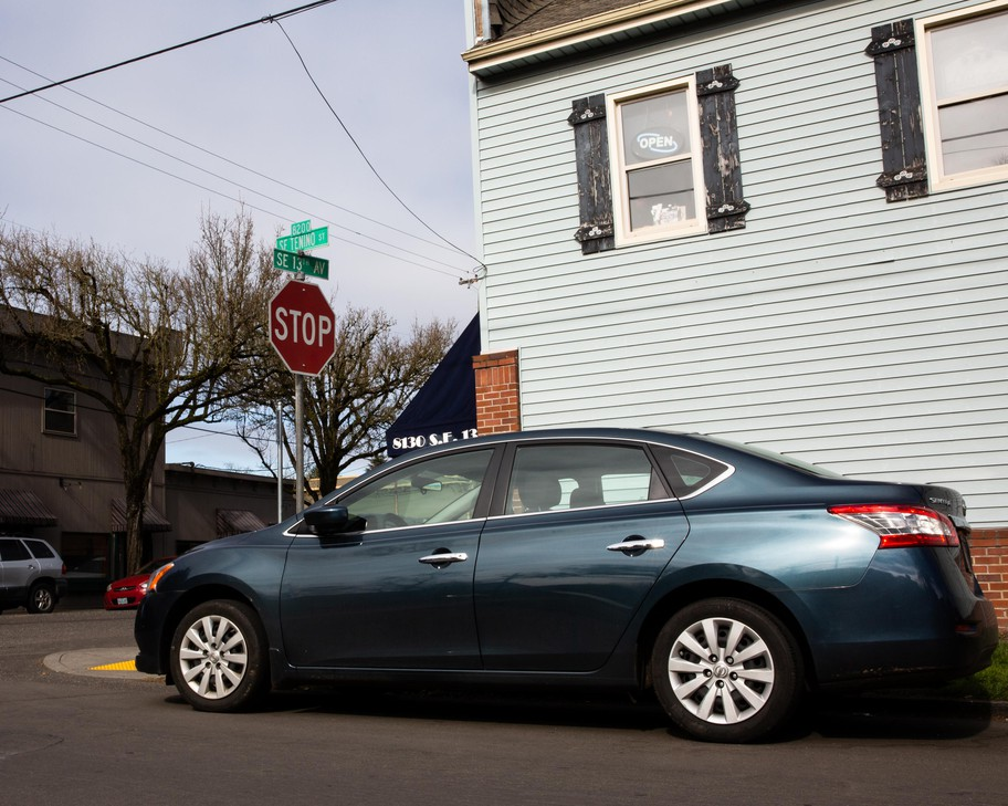 A car sits parked next to a crosswalk in Southeast Portland, Ore., Saturday, Feb. 22, 2020. A $5.9 million lawsuit claims Portland knowingly ignores Oregon law by allowing drivers to park too close to crosswalks and intersections.